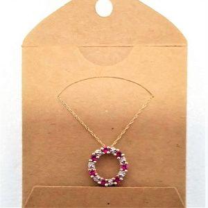 Gold tone round red and white CZ necklace